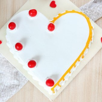 Heart Shaped Vanilla Cake With Cherries On Top - Top View