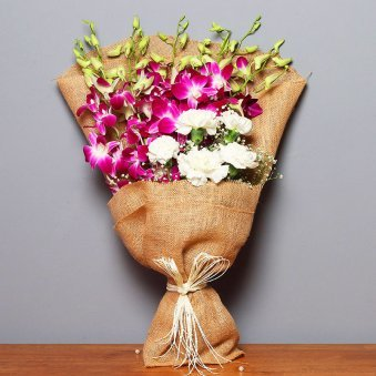 Bunch of Purple Orchids and Roses in Jute Packing