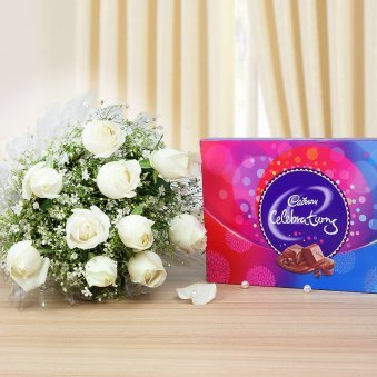 Perfect Celebrations - A gift hamper of 10 white roses and chocolates