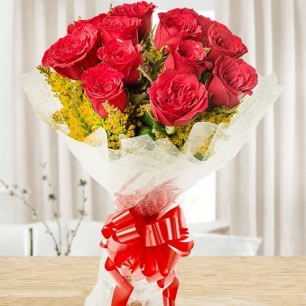 Front view of bunch of 12 red Roses - A gift of Love And Luck Hamper