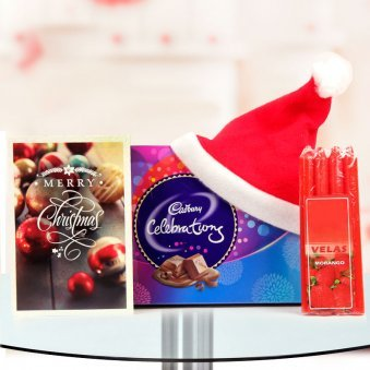 A happy assortment of 4 candles, a greeting card, a delightful pack of Cadbury Celebrations and a classic Santa cap with a petite charm