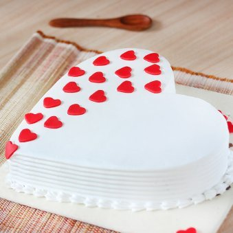 Heart Shaped Vanilla Cake With Hearts On It - Cross View
