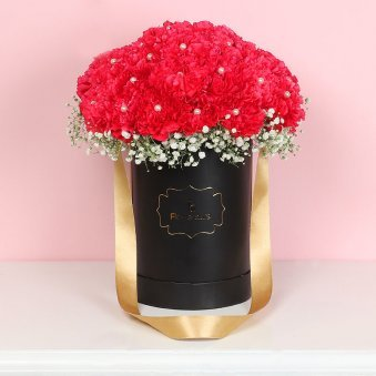 Bunch of Red Carnations in a Flower Box