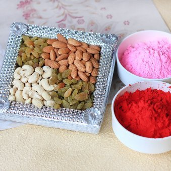 A combo having a pack of dry fruits and two packs of herbal Gulal