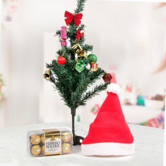 Ferrero Rocher chocolates with red Santa cap and a beautifully decorated artificial Christmas tree