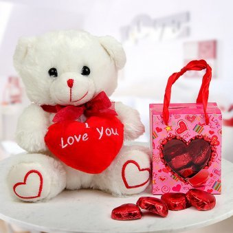 A 6 inch white Teddy that says I Love You and A box of heart-shaped handmade chocolates