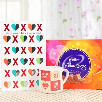 A beautiful mug and a cadbury celebrations pack with a greeting card