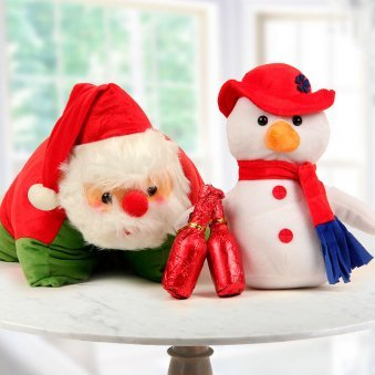 A Santa Pillow with a Cuddly Snowman and 2 Champagne shaped handmade chocolates