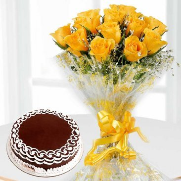 Yellow flowers bunch and Cake for Holi