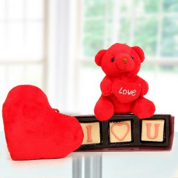 A tiny 3 inches yellow teddy bear and A heart-shape box of handmade chocolates