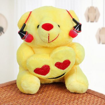 Yellow Teddy with Pink Earphones
